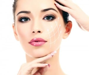 A beautiful woman's face with white lines creating a grid on her cheek, on a white background