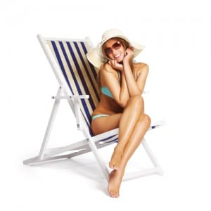 bikini woman in hat sitting in beach chair